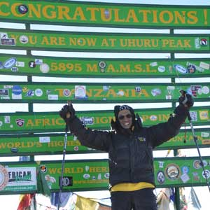 Akil Taher at the summit of Mt. Kilimanjaro.